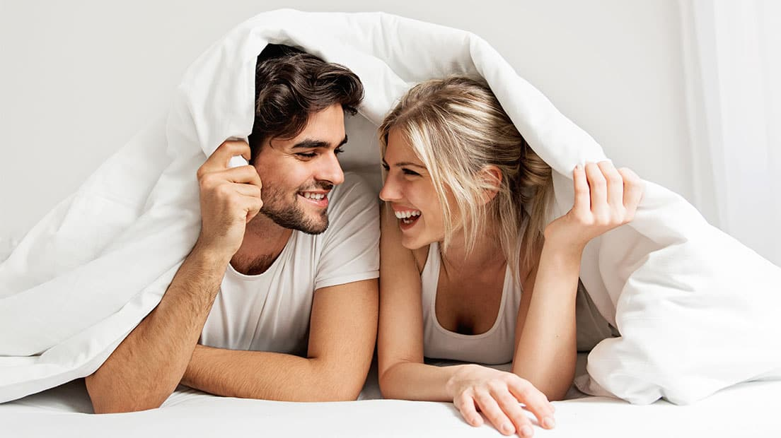 couple-laughing-in-bed